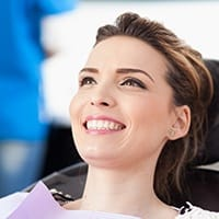 Smiling woman in dental exam room