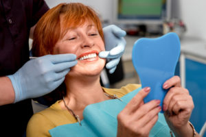 Mature woman having her teeth examined